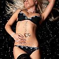 Blond in black lingerie covered in diamonds Poster by Richard Thomas