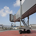 Boarding Bridge Leading to a Parked Plane Print by Jaak Nilson