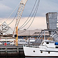 Boat and old crane reflections Print by David Lade