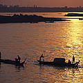 Boats Silhouetted On The Mekong River Print by Steve Raymer