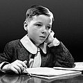 Boy Sitting At Desk W/book Poster by George Marks