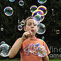 Boy with colorful bubbles Poster by Matthias Hauser