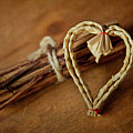 Braided Wicker Heart On Small Bundled Wood Poster by Alexandre Fundone