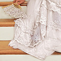 Bride Sitting on Stairs with Lace Fan Print by Jill Battaglia
