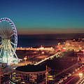 Brighton Wheel And Seafront Lit Up At Night Poster by PhotoMadly