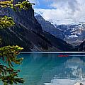 Canoe on Lake Louise Poster by Larry Ricker