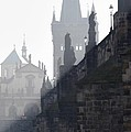 Charles bridge in the early morning fog Print by Michal Boubin