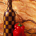 Checker wine bottle and red pepper Print by Garry Gay