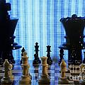 Chess board with King and Queen chess pieces in front of TV scre Poster by Sami Sarkis
