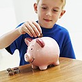 Child With A Piggy Bank Print by Ian Boddy
