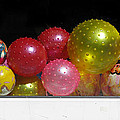 Colorful Balls In The Shop Window Print by Ausra Paulauskaite