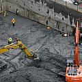 CONSTRUCTION SITE diggers and workmen in the foundation pit of a new building Seattle Poster by Andy Smy