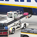 Conveyor Unloading Luggage Print by Jaak Nilson