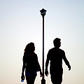Couple Exercise While Walking At Sunset Poster by Virginia Star