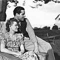 Couple Relaxing On Deckchair In Garden, (b&w) Poster by George Marks