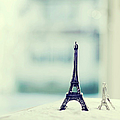Eiffel Tower Still Life With Blurry Blue Backgroun Print by Kristy Campbell