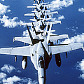 Fa-18c Hornet Aircraft Fly In Formation Print by Stocktrek Images