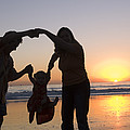Family Portrait On The Beach At Sunset Print by Rich Reid