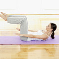Germany, Hamburg, Woman Doing Yoga Exercise In Gym Room Print by Westend61