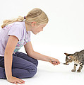 Girl Feeding Kitten From A Spoon Print by Mark Taylor