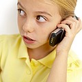 Girl Using Mobile Phone Poster by Ian Boddy