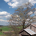 Hillside Weathered Barn Dramatic Spring Sky Print by John Stephens