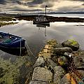 Islay, Scotland Two Boats Anchored By A Poster by John Short