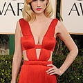 January Jones Wearing A Versace Dress Poster by Everett