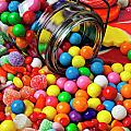 Jar spilling bubblegum with candy Print by Garry Gay