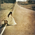 Lady in Gown Sitting by Road on Suitcase Print by Jill Battaglia