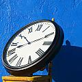Large clock on yellow chair Print by Garry Gay