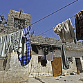 Laundry Hangs In The Courtyard Print by Stocktrek Images