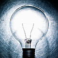 Light Bulb On Stainless Steel Background. Print by ballyscanlon