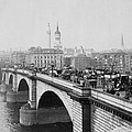 London Bridge showing carriages - coaches and pedestrian traffic - c 1900 Poster by International  Images