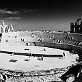 looking down on main arena of old roman colloseum el jem tunisia Print by Joe Fox
