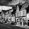 main road through the picturesque small town of Callander scotland uk Print by Joe Fox