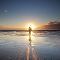 Man Walking On Beach At Sunset Poster by Stu Meech
