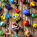 Marbles on wooden board Poster by Garry Gay