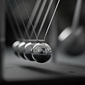 Newton's Cradle In Motion - Metallic Balls Print by N.J. Simrick