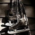 Old hockey skates with scarf hanging on a wall Poster by Sandra Cunningham