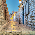 Old Stone Alleyway With Electric Lights Poster by Noam Armonn