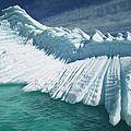 Overturned Iceberg With Eroded Edges Poster by Colin Monteath