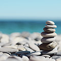Pile Of Stones On Beach Poster by dhmig photography