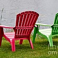 Pink and Green Lounging Chairs by the Lake Poster by Louise Heusinkveld