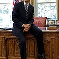 President Barack Obama Sits On The Edge Poster by Everett