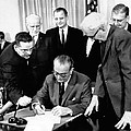 President Lyndon Johnson Signs The 24th Poster by Everett