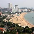 Qingdao Beach with Skyline Print by Carol Groenen