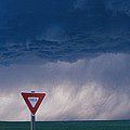 Rain Pours Out Of Dark Clouds On Plains Poster by Carsten Peter