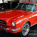 Red 1965 Ford Mustang . Front Angle Poster by Wingsdomain Art and Photography
