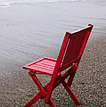 Red chair on the beach Print by Garry Gay